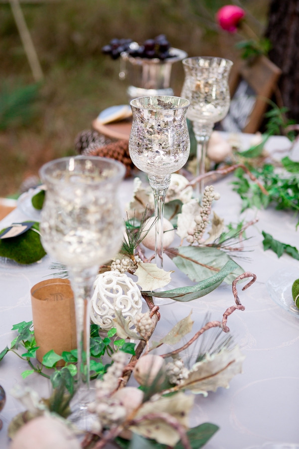 Row of glasses on woodland styled wedding table