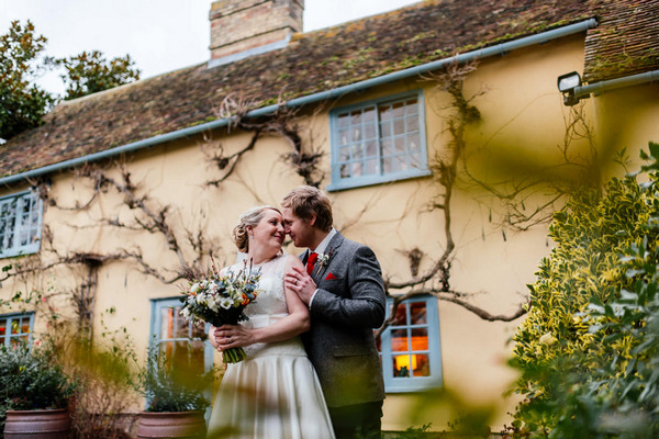 Bride and groom about to kiss outside South Farm, Royston