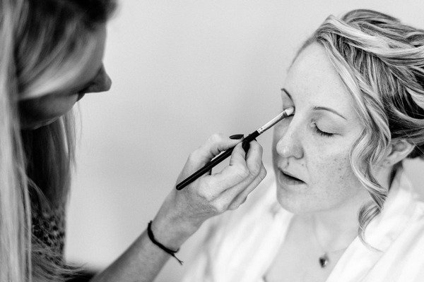 Bride having eye make-up applied