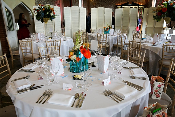 Wedding table with colourful flower centrepiece