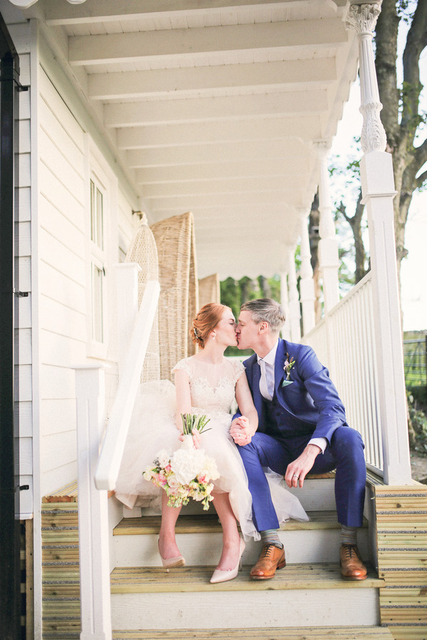 Bride and groom kissing on steps