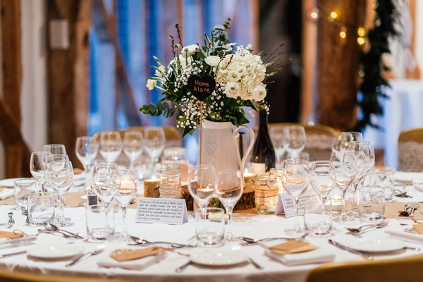Wedding table with jug of flowers