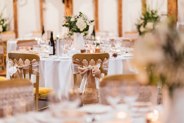 Rustic hessian bow on back of wedding chair