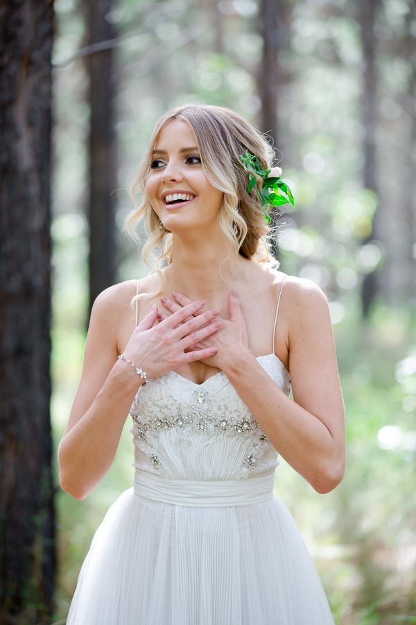 Bride with hands in chest