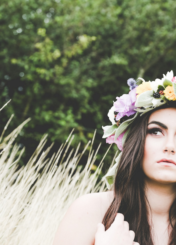 Bride with long dark hair wearing flower crown