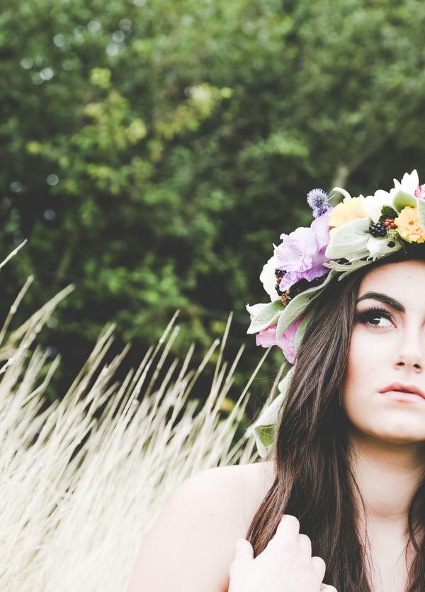 Bride with long dark hair wearing flower crown