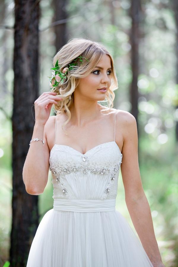 Bride touching hair