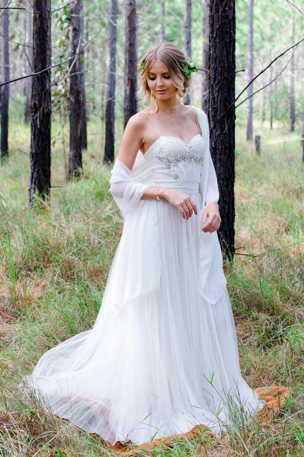 Bride with long wedding dress and shawl