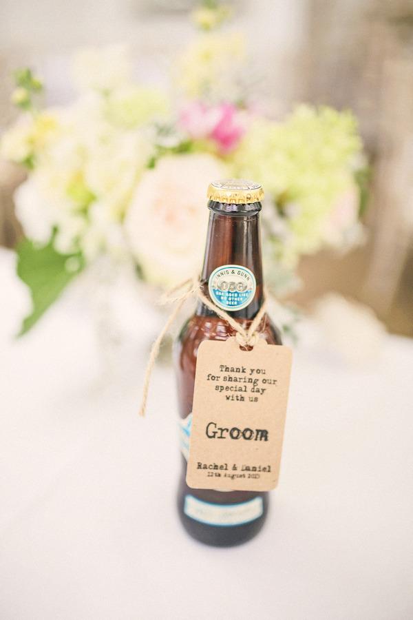 Bottle of beer with groom tag