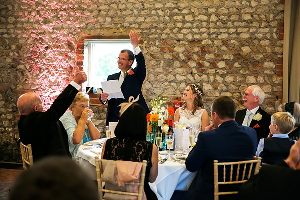 Raising toast at wedding