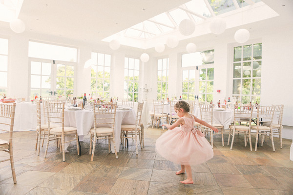 Flower girl by tables at Woodhill Hall