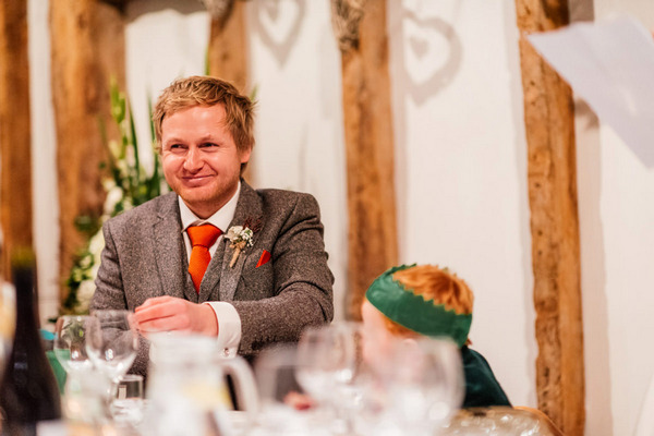 Groom listening to wedding speech