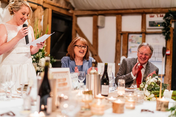 Parents laughing at bride's wedding speech