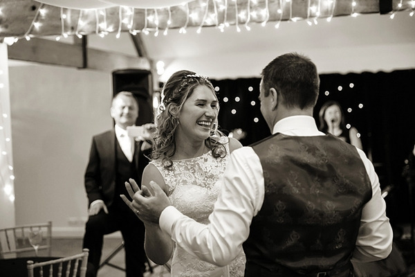 Happy bride and groom on dance floor