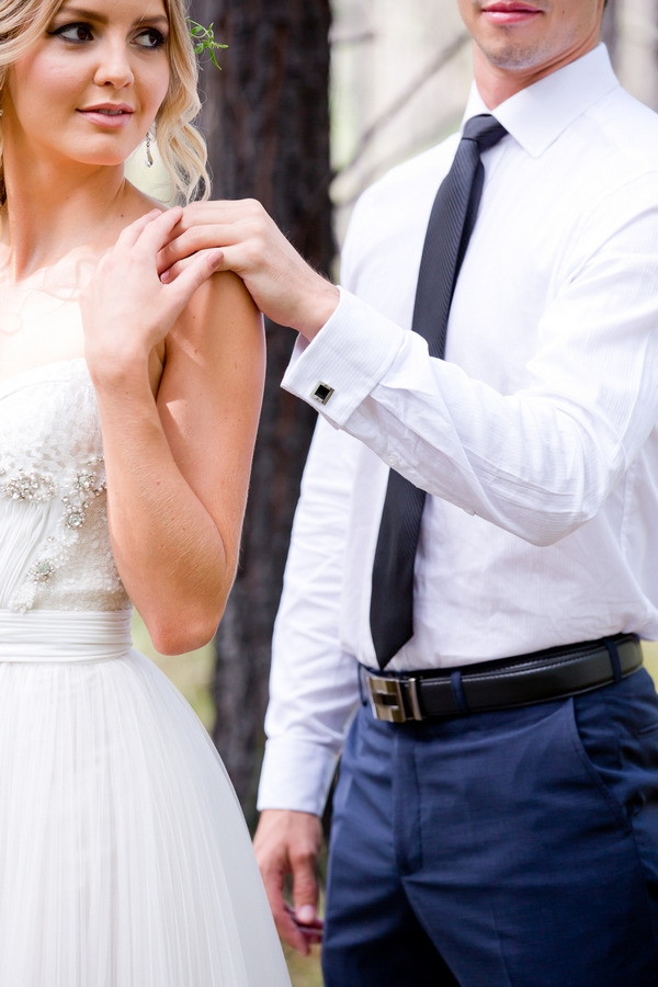 Groom with hand on bride's shoulder