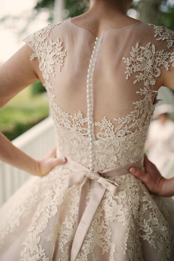 Lace detail on back of bride's House of Mooshki wedding dress