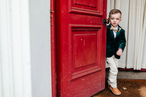 Pageboy standing by red door