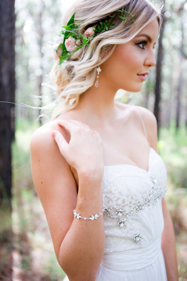 Bride with updo and flower hairpiece