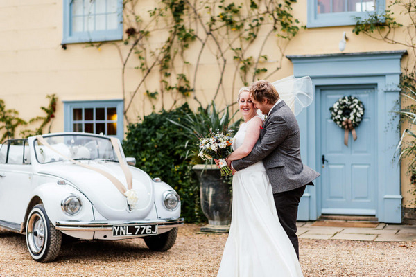 Bride and groom outside South Farm in Royston