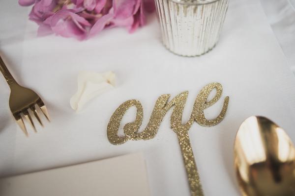 Metallic gold wedding table number