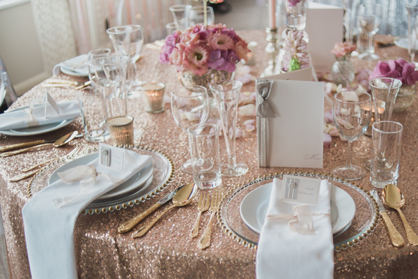 Wedding table with metallic gold sequin table cloth