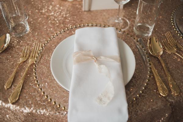 Metallic gold wedding place setting