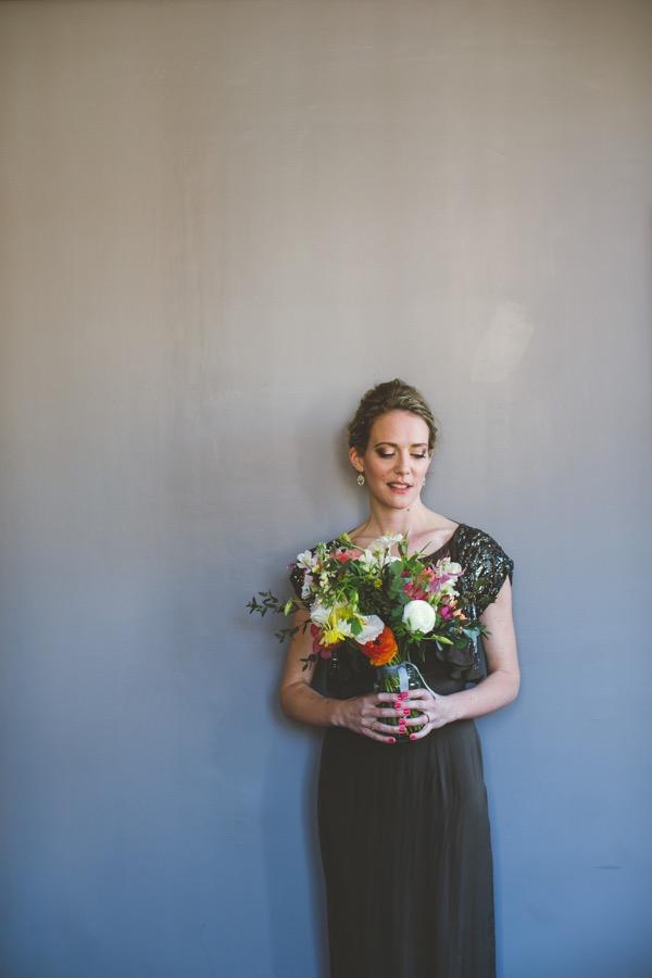 Bride in mink dress holding bouquet