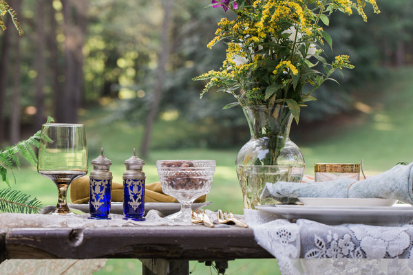Blue glassware on rustic wedding table