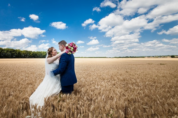 Bride and groom in corn field with beautiful blue sky - Picture by KE Southall Photography