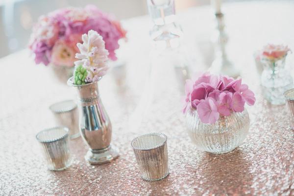 Pink flowers in metallic votives