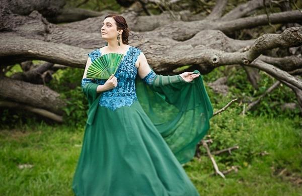 Bride posing in green wedding dress