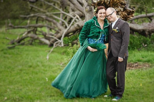 Bride in green wedding dress standing with groom