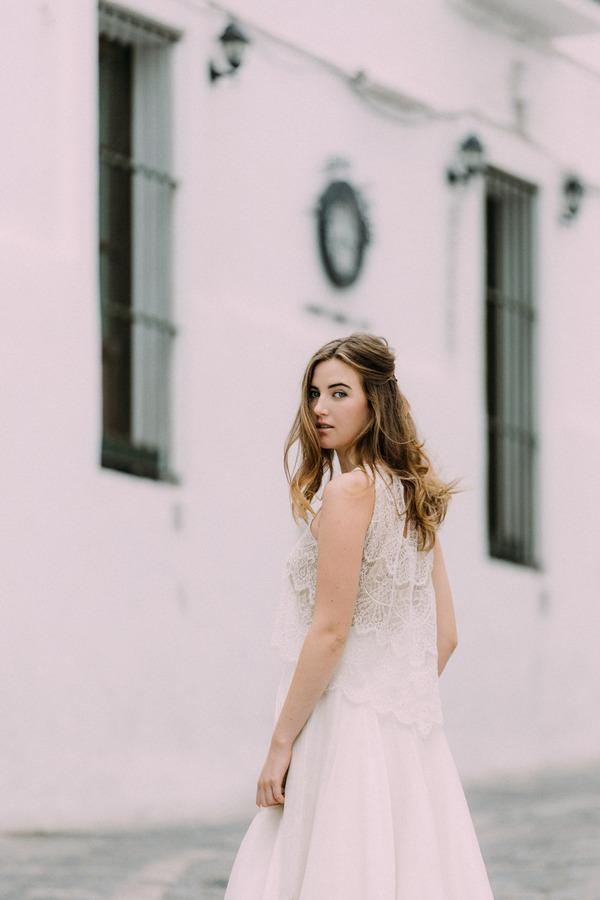 Back of bride's lace detailed boho wedding dress