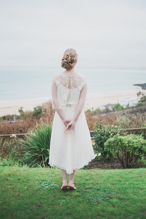 Bride standing with hands behind back
