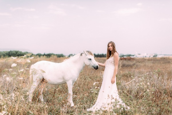 Bride in field with horse