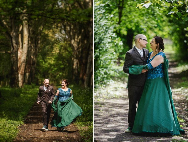Bride and groom running through woodland