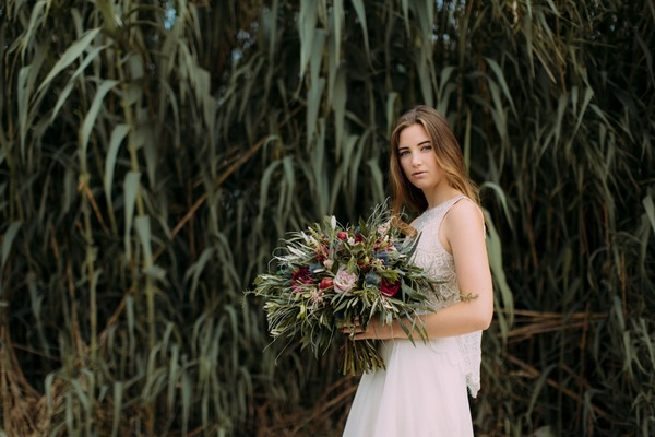 Bride holding large rustic wedding bouquet