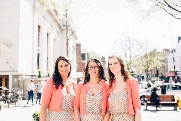 Bridesmaids wearing blush dresses and cardiagns