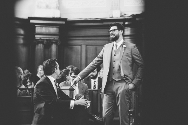 Groom waiting in Islington Town Hall for bride