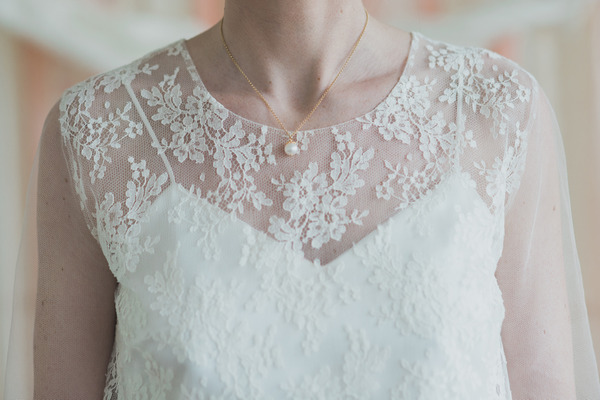 Lace detail on front of bride's wedding dress