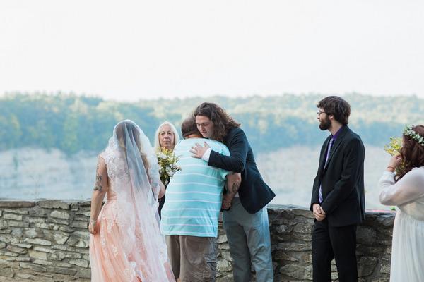 Groom hugging bride's father