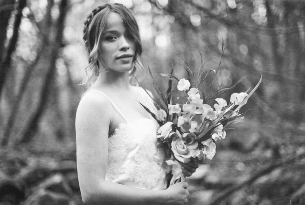 Bride with hair plait holding bouquet