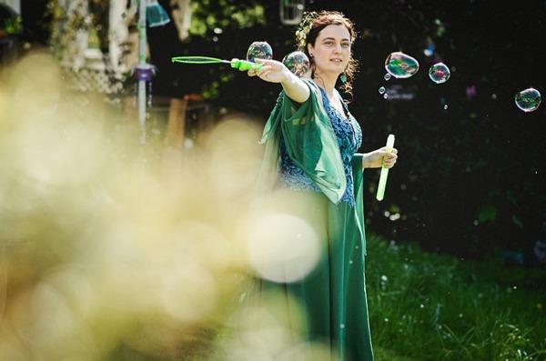 Bride using bubble wand