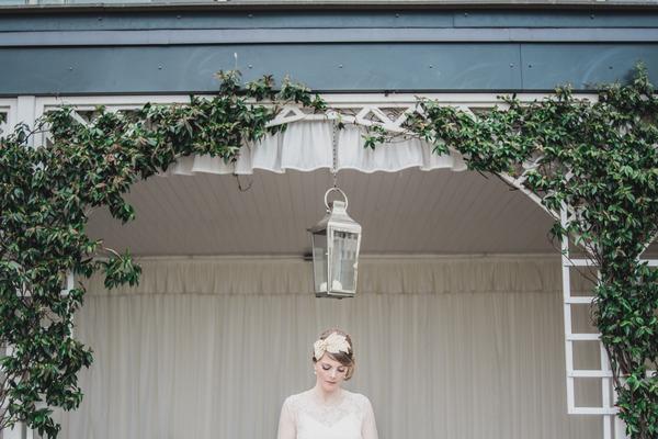 Bride standing under hanging lantern