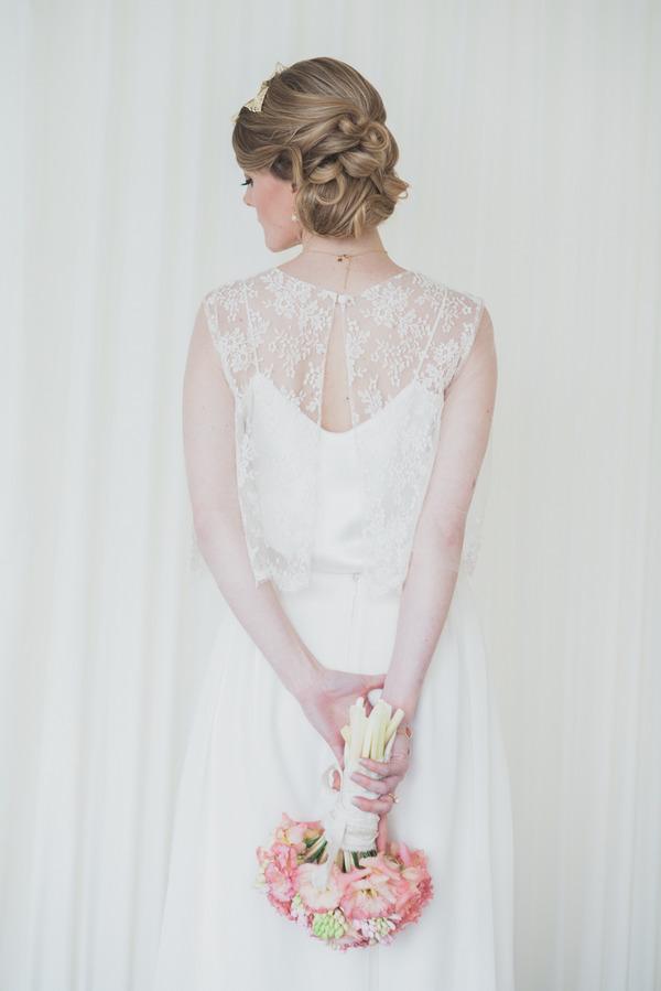Bride holding bouquet behind back