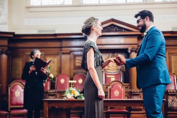 Bride and groom saying wedding vows in Islington Town Hall