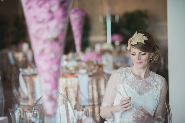 Bride sitting in chair at wedding table