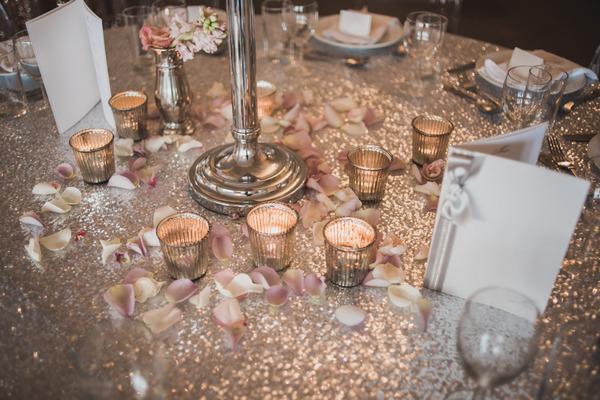 Tea lights on gold metallic wedding table cloth