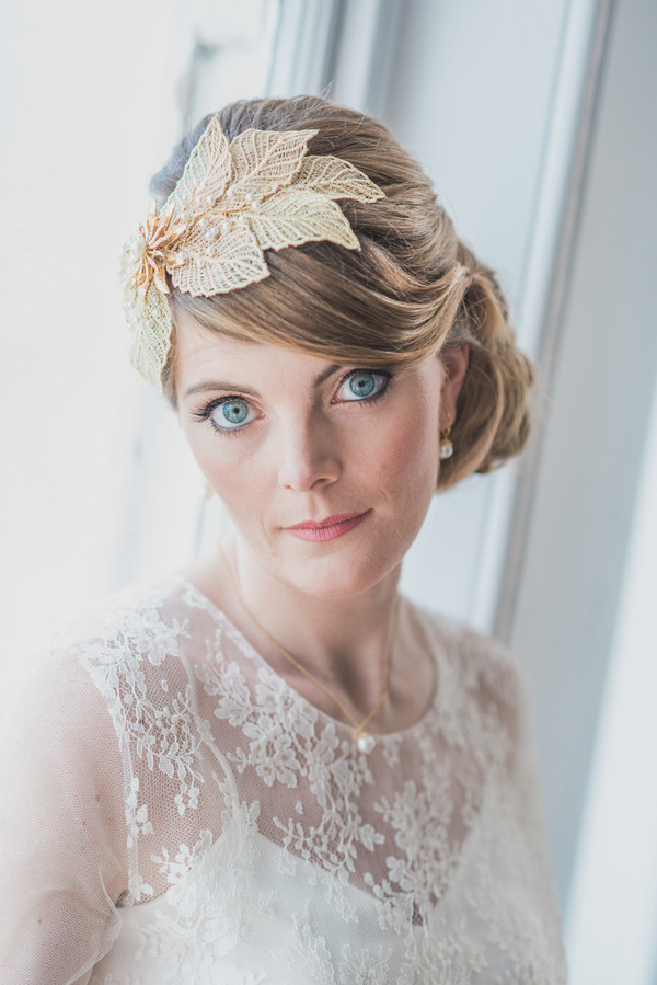 Bride with leaf hair accessory staring at camera