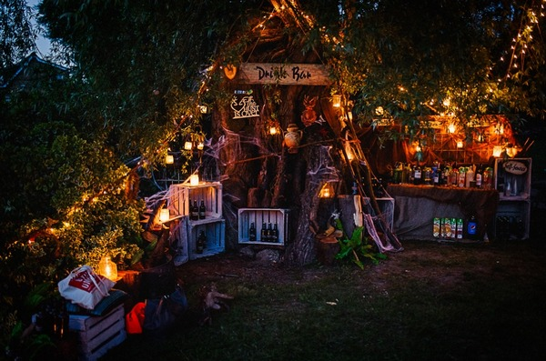 Wedding drinks bar around a tree